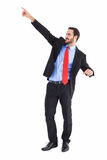Uomo d'affari bello sorridente che indica dito Immagini Stock