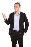 Uomo d'affari biondo isolato infelice che presenta sopra il bianco fotografie stock libere da diritti