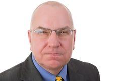 Uomo d'affari calvo di mezza età vendicativo Fotografia Stock