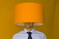 Uomo d'affari capo della lampada Fotografie Stock