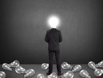 Uomo d'affari capo della lampada, concetto di idea Immagine Stock