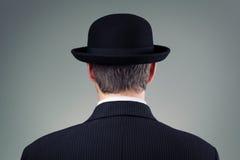 Uomo d'affari in cappello di giocatore di bocce Fotografia Stock
