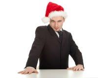 Uomo d'affari in cappello rosso di natale Fotografia Stock Libera da Diritti
