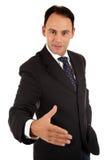 Uomo d'affari caucasico pronto per l'agitazione della mano. Fotografia Stock