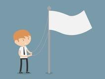 Uomo d'affari che alza una bandiera Fotografia Stock Libera da Diritti