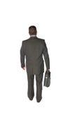 Uomo d'affari che cammina via Immagini Stock