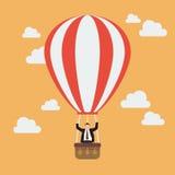 Uomo d'affari che celebra in mongolfiera Fotografie Stock Libere da Diritti