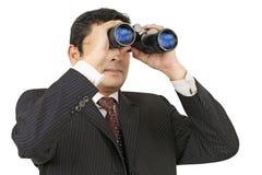 Uomo d'affari che cerca con il binocolo Fotografie Stock Libere da Diritti