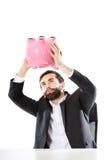 Uomo d'affari che cerca soldi in porcellino salvadanaio Fotografia Stock Libera da Diritti