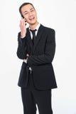 Uomo d'affari che chiama con un sorriso Fotografia Stock