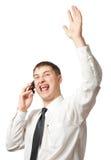 Uomo d'affari che chiama dal telefono e che aumenta sulla mano Fotografia Stock Libera da Diritti