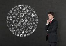 Uomo d'affari che considera le icone di media Immagine Stock Libera da Diritti