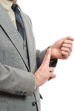 Uomo d'affari che controlla il suo impulso Fotografia Stock