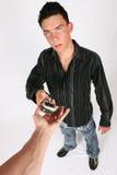 Uomo d'affari che cosegna il suo telefono Fotografie Stock