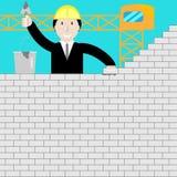Uomo d'affari che costruisce un muro di mattoni Fotografie Stock Libere da Diritti