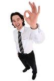 Uomo d'affari che dà gesto GIUSTO Immagine Stock