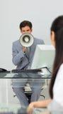 Uomo d'affari che dà le istruzioni con un megafono Fotografia Stock Libera da Diritti