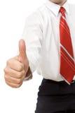 Uomo d'affari che dà pollice sul segno Fotografia Stock