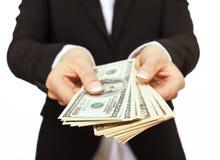 Uomo d'affari che dà i soldi del dono Fotografie Stock