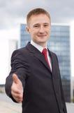 Uomo d'affari che dice benvenuto Immagini Stock