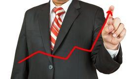 Uomo d'affari che disegna una linea su fondo bianco Immagini Stock