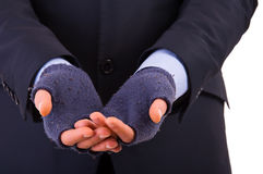 Uomo d'affari che elemosina i soldi. fotografia stock