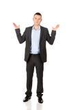 Uomo d'affari che fa gesto indeciso Fotografie Stock Libere da Diritti