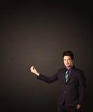 Uomo d'affari che fa i gesutres Fotografia Stock Libera da Diritti