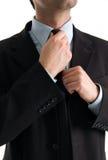 Uomo d'affari che fa suo legame Immagini Stock Libere da Diritti