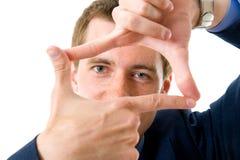 Uomo d'affari che fa un blocco per grafici con le sue mani Fotografie Stock