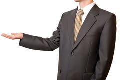 Uomo d'affari che gesturing con la mano vuota Immagini Stock
