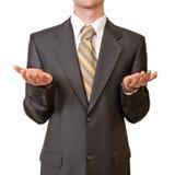 Uomo d'affari che gesturing con la mano vuota Fotografie Stock