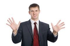 Uomo d'affari che gesturing le mani Immagine Stock