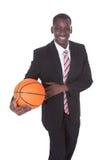 Uomo d'affari che gioca pallacanestro Fotografie Stock