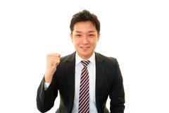 Uomo d'affari che gode del successo Immagini Stock