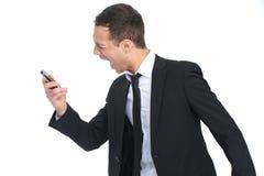 Uomo d'affari che grida al telefono Fotografie Stock Libere da Diritti