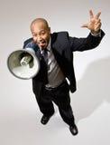 Uomo d'affari che grida nel megafono Fotografie Stock Libere da Diritti