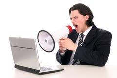 Uomo d'affari che grida tramite il megafono Fotografie Stock Libere da Diritti
