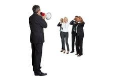 Uomo d'affari che grida tramite un megafono Immagini Stock