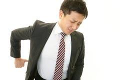 Uomo d'affari che ha dolore alla schiena Fotografia Stock