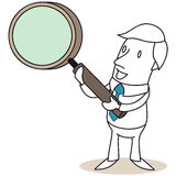 Uomo d'affari che indica con la lente d'ingrandimento Fotografia Stock Libera da Diritti