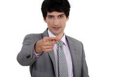 Uomo d'affari che indica il suo dito Immagine Stock