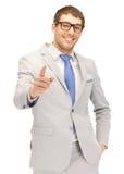 Uomo d'affari che indica la sua barretta Fotografia Stock