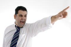 Uomo d'affari che indica lato Immagini Stock Libere da Diritti