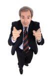 Uomo d'affari che indica sulle sue barrette Fotografia Stock Libera da Diritti