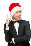 Uomo d'affari che indossa i gesti di attenzione del cappuccio di Santa Claus immagini stock libere da diritti