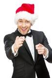 Uomo d'affari che indossa il cappuccio di Santa Claus Immagini Stock Libere da Diritti