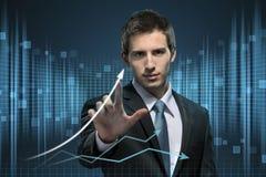 Uomo d'affari che lavora con la tecnologia virtuale Fotografia Stock