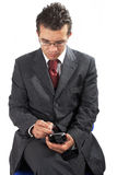 Uomo d'affari che lavora con PDA immagine stock