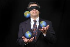 Uomo d'affari che manipola con la terra del pianeta Fotografia Stock Libera da Diritti